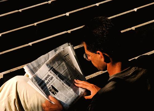 man reading news