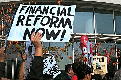 Protestor demands financial reform.