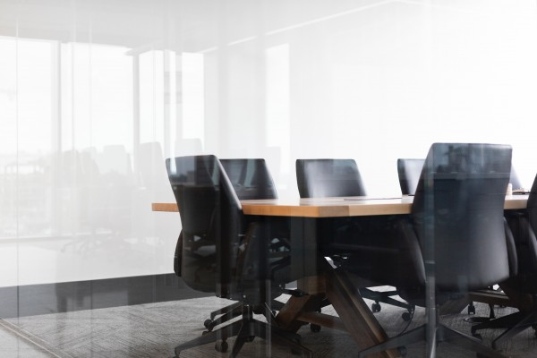 a corporate boad room full of empty chairs - Photo by Drew Beamer on Unsplash