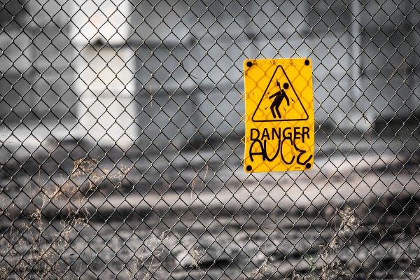 fence with a yellow sign that says 'danger' = Photo by JF Martin on Unsplash