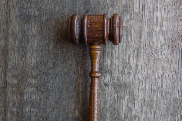 gavel from a courtroom - Photo by Wesley Tingey on Unsplash