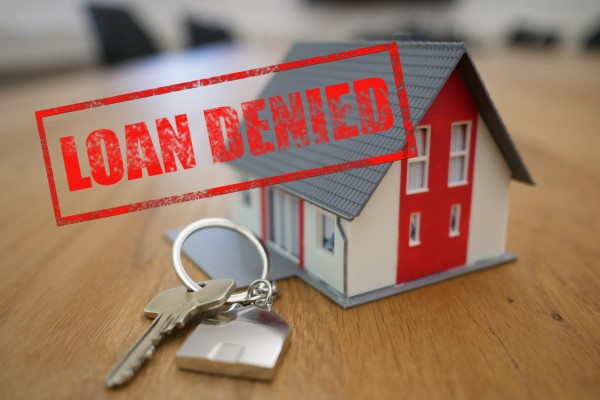keys to a new house with the stamp LOAN DENIED over top of the image