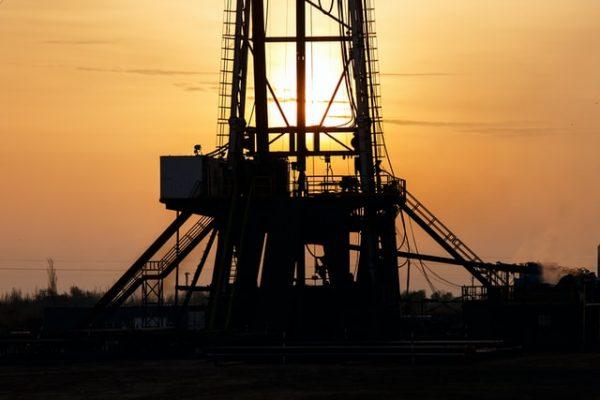 oil rig at sunset Photo by WORKSITE Ltd. on Unsplash