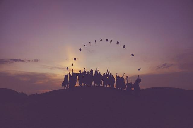 image of graduates throwing caps